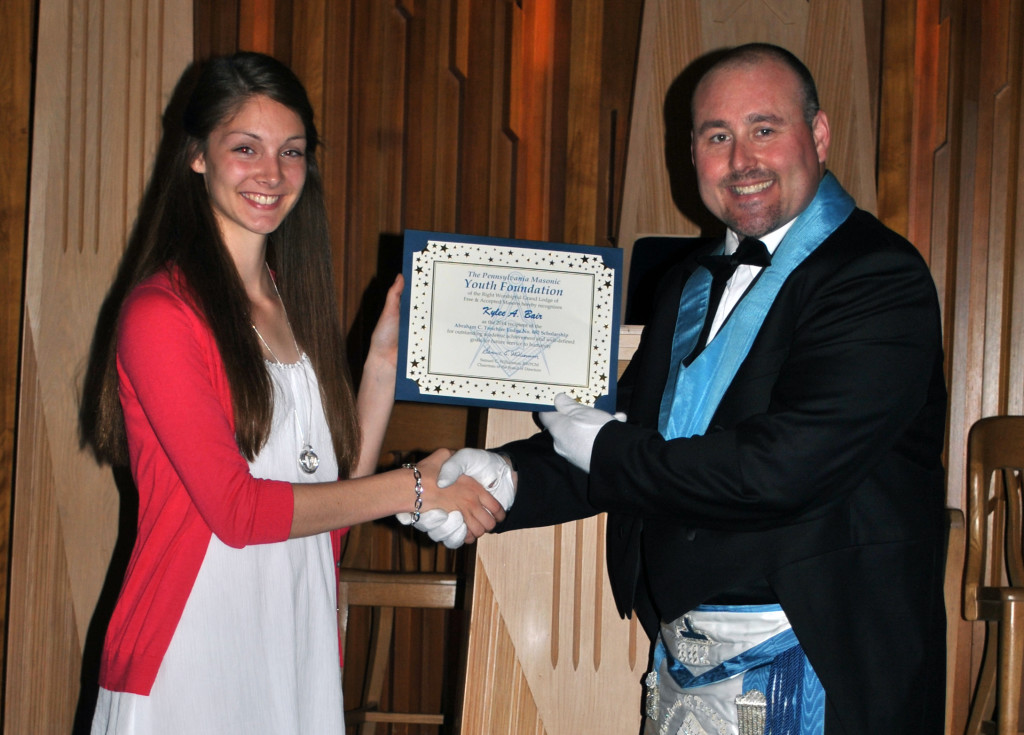 Miss Bair receives the scholarship from Bro. Stephen E. Poff, Worshipful Master.